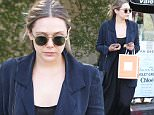 Picture Shows: Elizabeth Olsen  February 26, 2016\n \n 'Godzilla' actress Elizabeth Olsen was spotted shopping on Melrose in Los Angeles, California. Elizabeth recently returned from Italy where she attended Milan Fashion Week. \n \n Non-Exclusive\n UK RIGHTS ONLY\n \n Pictures by : FameFlynet UK © 2016\n Tel : +44 (0)20 3551 5049\n Email : info@fameflynet.uk.com