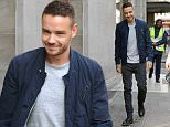 26 Feb 2016 - LONDON - UK\n*** EXCLUSIVE ALL ROUND PICTURES ***\n** STRICTLY NOT AVAILABLE FOR MAIL ONLINE AND ANY ONLINE SUBSCRIPTION DEALS UNLESS FEE AGREED PRIOR TO USAGE***\nDays after winning a brit award a tanned and happy Liam Payne is spotted visiting sony hq in london with friend paul chung owner of nightclub Funky Buddha. Liam posed for a fan photo and then tried to walk along to the camera giving a mean moody look which he couldnt sustain bursting into big smiles at the end. Liam spent just 30 minutes at sony saying he was in a big rush.\nBYLINE MUST READ : XPOSUREPHOTOS.COM\n***UK CLIENTS - PICTURES CONTAINING CHILDREN PLEASE PIXELATE FACE PRIOR TO PUBLICATION ***\n**UK CLIENTS MUST CALL PRIOR TO TV OR ONLINE USAGE PLEASE TELEPHONE 44 208 344 2007**
