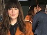 148870, Jamie Dornan and Dakota Johnson film scenes for 'Fifty Shades Darker' in the rain in Vancouver. The two shared a kiss during the scene and then broke out in a laughing fit. Vancouver, Canada - Tuesday March 1, 2016. Photograph: © Kred, PacificCoastNews. Los Angeles Office: +1 310.822.0419 sales@pacificcoastnews.com FEE MUST BE AGREED PRIOR TO USAGE