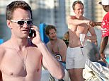 *** UK ONLY *** *** MAIL ONLINE OUT ***148757, A shirtless Neil Patrick Harris and his husband David Burtka enjoy an afternoon of wine with friends on the beach in Miami. Neil and David spent the day at the South Beach Wine and Food Festival, and appeared to carry on their fun with some friends as they hit the beach at the end of the day. Neil drank wine while chatting on the phone, in just white shorts and matching sunglasses before joining his husband and friends. David appropriately wore a watermelon T shirt, at one point giving it to a friends young child to wear. The friendly pair drank wine, and laughed with friends, Neil even took the time to talk to, and fist bump a fan. Miami, Florida - Saturday February 27, 2016. \nPHOTOGRAPH BY Pacific Coast News / Barcroft Media\nUK Office, London.\nT +44 845 370 2233\nW www.barcroftmedia.com\nUSA Office, New York City.\nT +1 212 796 2458\nW www.barcroftusa.com\nIndian Office, Delhi.\nT +91 11 4053 2429\nW www.barcroftindia.com