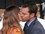 """1.March.2016 - Vancouver - Canada *** STRICTLY AVAILABLE FOR UK AND GERMANY USE ONLY *** Dakota Johnson and Jamie Dornan share an intimate moment on the set of the erotic movie """"50 Shades Darker"""". BYLINE MUST READ : AKM-GSI-XPOSURE ***UK CLIENTS - PICTURES CONTAINING CHILDREN PLEASE PIXELATE FACE PRIOR TO PUBLICATION *** *UK CLIENTS MUST CALL PRIOR TO TV OR ONLINE USAGE PLEASE TELEPHONE 0208 344 2007*"""