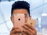A man takes pictures as the Apple iPhone 6s and 6s Plus go on sale at an Apple Store in Beijing, China, in this September 25, 2015.   Apple's China sales grew 84 percent in the last year through September. But with China's economy growing at its slowest pace in a quarter of a century in 2015, there are concerns that consumers are tightening their purse strings.      REUTERS/Damir Sagolj/Files