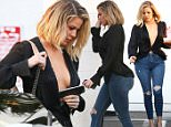 Van Nuys, CA - Khloe Kardashian goes braless in a deep V silky blouse as she leaves the studio. She looks sexy and stylish as she pairs it with distressed jeans and a killer pair of Christian Louboutin pumps. She's also seen carrying food to-go, which explains why Khloe's body has been looking more and more fabulous. \n  \nAKM-GSI       March 1, 2016\nTo License These Photos, Please Contact :\nSteve Ginsburg\n(310) 505-8447\n(323) 423-9397\nsteve@akmgsi.com\nsales@akmgsi.com\nor\nMaria Buda\n(917) 242-1505\nmbuda@akmgsi.com\nginsburgspalyinc@gmail.com