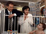 Tony Blair and Cherie Blair during the 1997 election campaign at the Childrens Hospital in Derby. They are with 8 month old Lauren Smith.