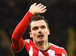 Adam Johnson of Sunderland celebrates scoring the opening goal during the Barclays Premier League match between Newcastle United and Sunderland at St James' Park on December 21, 2014 in Newcastle upon Tyne, England.     NEWCASTLE UPON TYNE, ENGLAND - DECEMBER 21:  (Photo by Laurence Griffiths/Getty Images)
