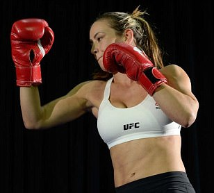 Miesha Tate believes that 'a good right hand could put Holly Holm down' as the pair