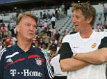 MUNICH, GERMANY - JULY 29:  Edwin van der Sar of Manchester United (R) speaks to Bayern Munich's coach Louis van Gaal ahead of the pre-season Audi Cup match between Manchester United and Boca Juniors at the Allianz Arena on July 29 2009 in Munich, Germany. (Photo by John Peters/Manchester United via Getty Images) *** Local Caption *** Edwin van der Sar;Louis van Gaal