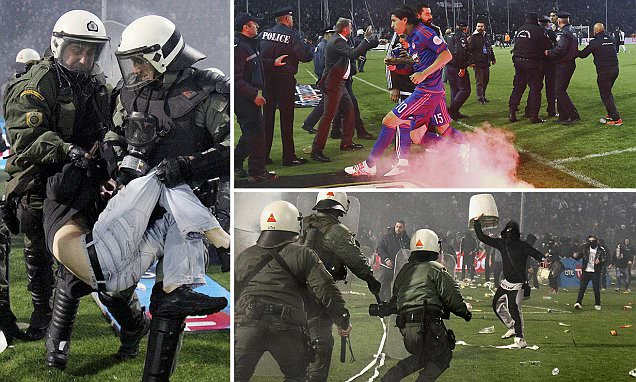 PAOK supporters storm the pitch to vent frustrations after being denied clear-cut penalty
