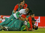 Bangladeshís Mahmudullah, on ground, and teammates celebrate after winning the Asia Cup Twenty20 international cricket match against Pakistan in Dhaka, Bangladesh, Wednesday, March 2, 2016. Bangladesh qualified for the final after beating Pakistan by five wickets. (AP Photo/A.M. Ahad)