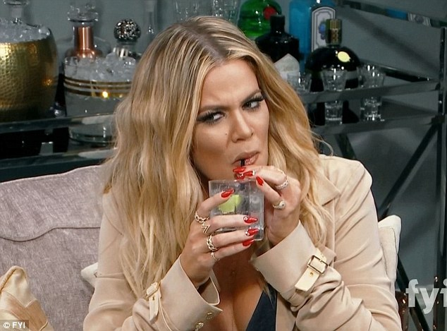 Drink up: Khloe pulled on a cocktail while hosting