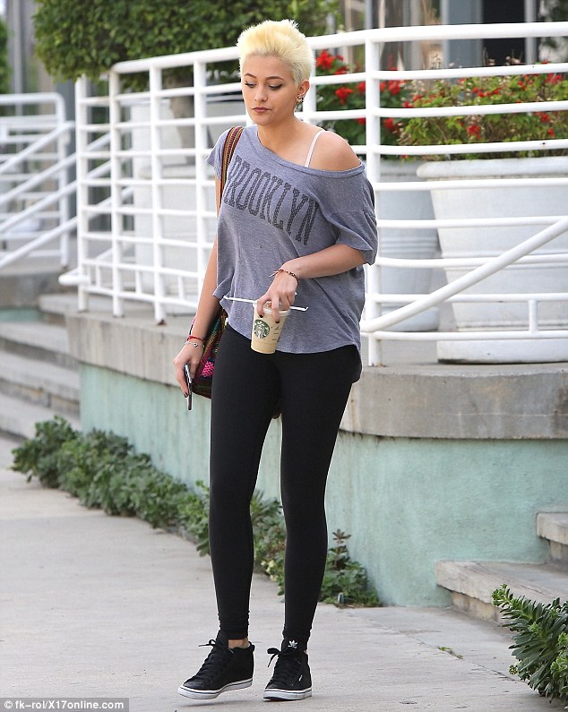 Punky Paris: Jackson's spiked hairstyle matched her street chic look in an off-the-shoulder top with the word Brooklyn emblazoned on the front