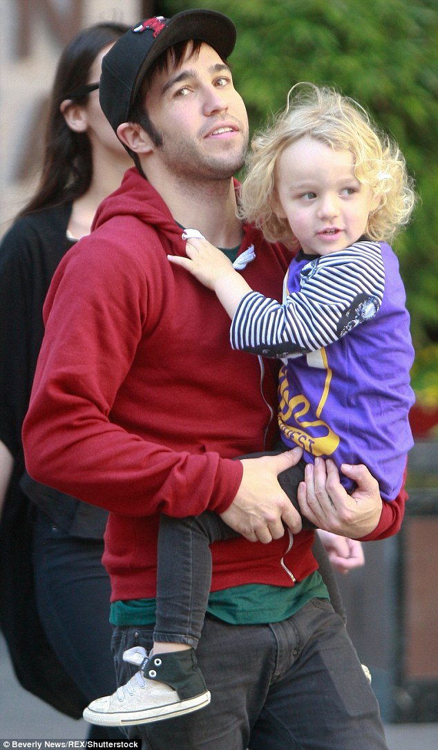 Honesty: Pete Wentz has revealed that becoming a father has helped him control his mood swings and likens fatherhood to taking 'happy pills'. He's pictured with son Bronx, from his marriage to Ashlee Simpson, in 2011