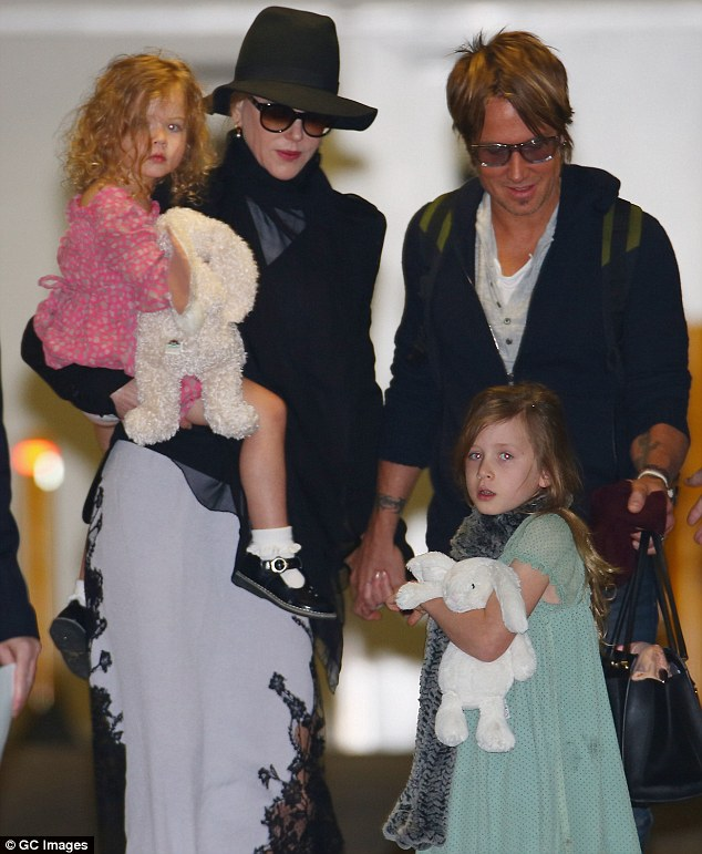 Happy family: The three-times Oscar nominee shares daughters Faith Margaret, seven, and Sunday Rose, five, with husband singer Keith Urban