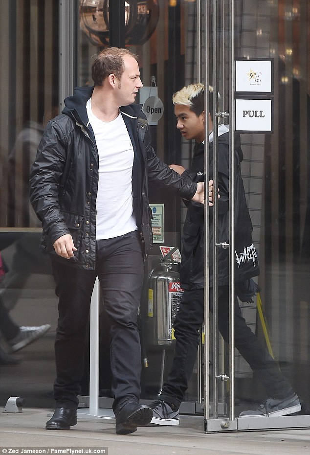 Hungry: The teen was joined by a bodyguard as he popped into the restaurant for a quick bite to eat