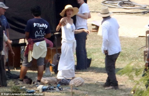 Shady: Angelina also shielded her face with a tan, wide-brimmed hat as she could be seen gesturing to her crew