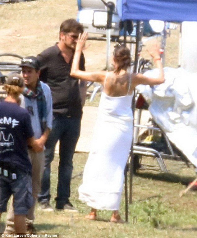 Proud: The open back on Angelina's dress revealed her new ink, done byher regular tattoo artist Ajarn Noo Kampai, whom she flew in from Bangkok to tattoo her