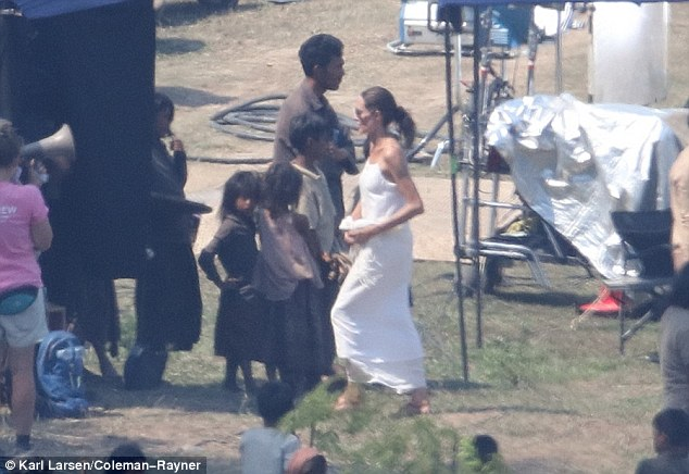 Getting down to business: Angelina wore her long, brunette tresses pulled back into a bun as she worked