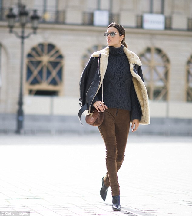 Walking the walk:Alessandra Ambrosio turned street style pin-up as she layered up in a chunky knit and a shearling coat during Paris Fashion Week on Wednesday