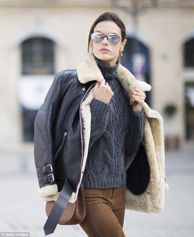 Keeping up with the Parisian fash-pack: Alessandra, 34, slipped her supermodel figure into some brown suede trousers, a grey cable-knit jumper and a biker coat as she strutted around the streets in between PFW shows