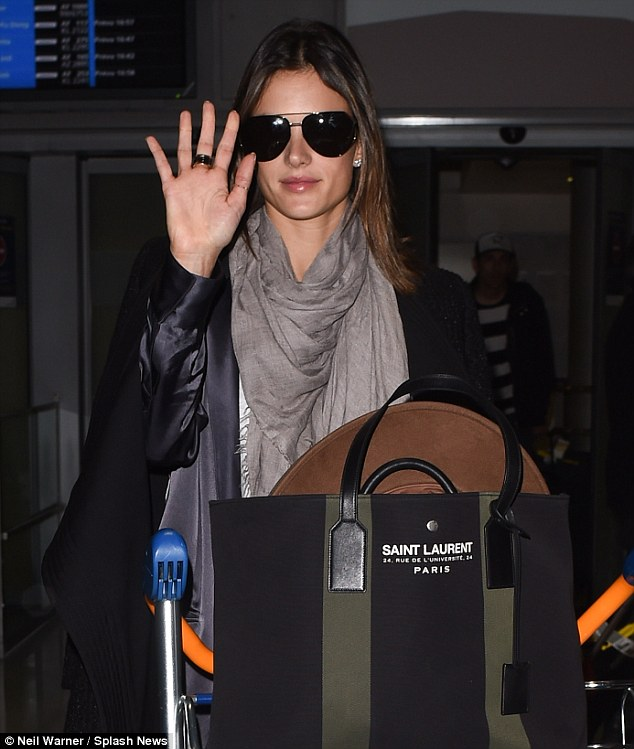 Bonjour Paris: The mother-of-two was pictured arriving atCharles De Gaulle Airport from Los Angeles earlier in the day