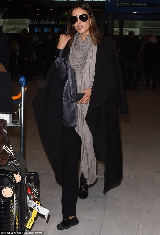 Jet-setting chic:She struck the perfect balance between style and comfort, swamping her slim figure in loose-fitting pieces for the long-haul flight