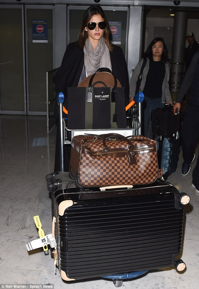 Got baggage: Alessandra was evidently well prepared for her PFW stint as she wheeled many suitcases through the terminal