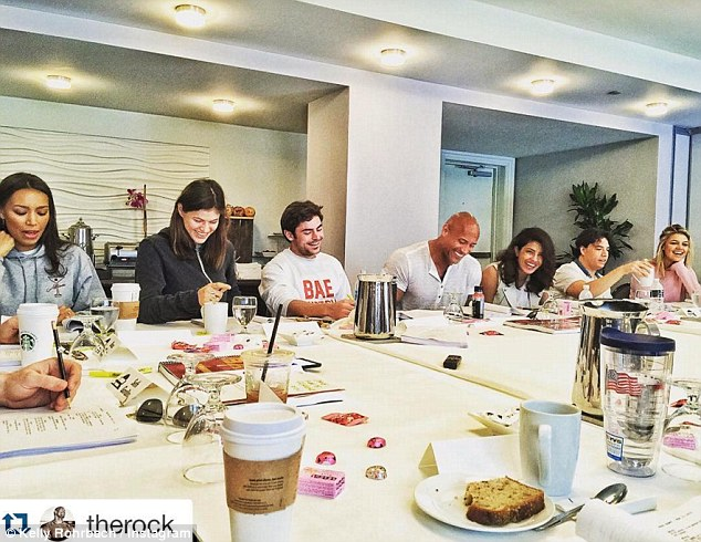 'Here we go': Kelly Instagrammed a snap of her Baywatch table read last week, captioning it, 'Here we go....#BAYWATCH starts filming tomorrow. We have such a hilarious and cool cast, amazing location, talented crew, writers, director, producers. It's gon be off the chain...get ready for a wild ride!'