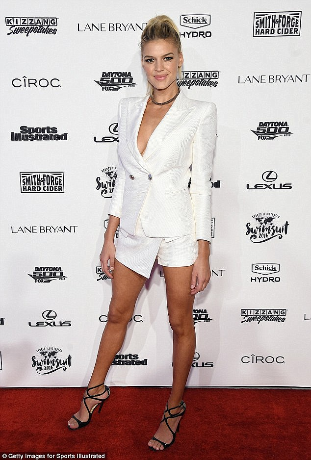 White hot! Rohrback sizzled in a low-cut white blazer at the Sports Illustrated Swimsuit launch in New York City in February