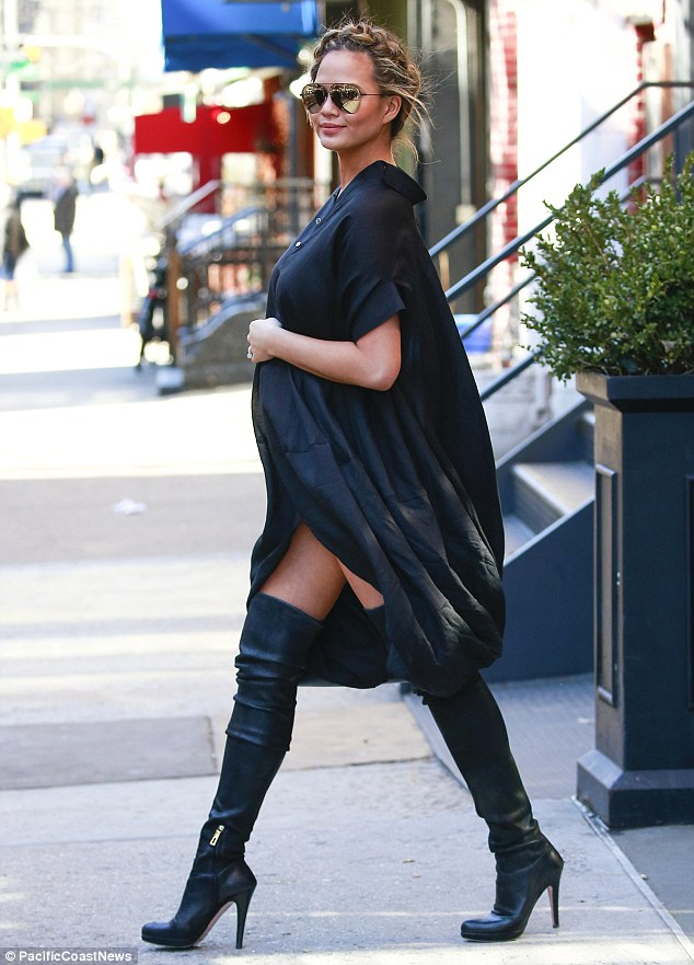 Thigh's the limit! Chrissy coupled the stylish dress with a pair of thigh-high, black leather boots as she left her apartment en route to Watch What Happens Live