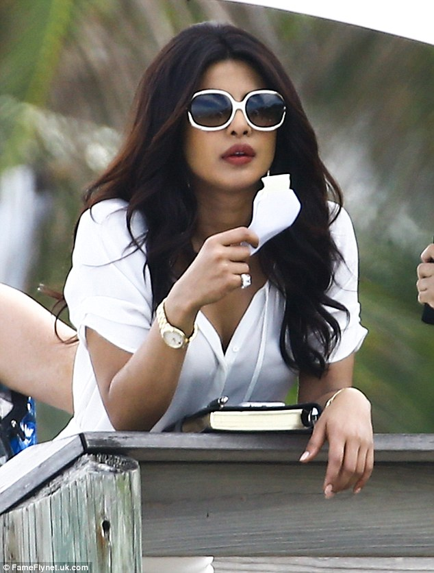 Baddie: She added giant white-framed sunglasses and had her voluminous wavy blow-out in a centre parting