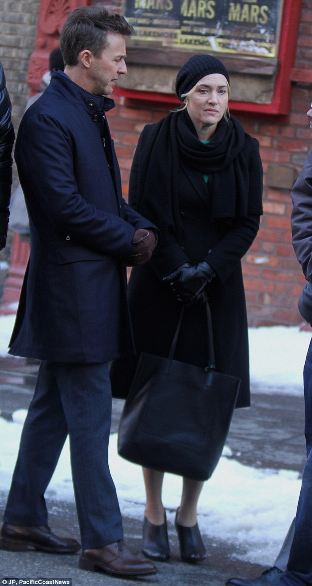Snow business like show business: With her new film Collateral Beauty being set in New York, Kate Winslet was forced to film a scenes alongside her co-star, Edward Norton, in some cold conditions on Wednesday