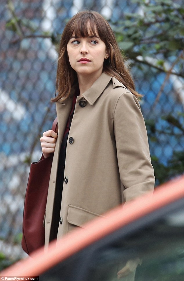 Back in the saddle: Dakota Johnson was seen back in her signature role as Anastasia Steele on the Vancouver, Canada set of Fifty Shades Darker