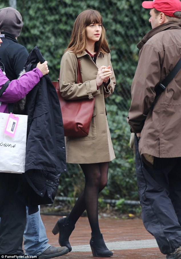 Showing her style: the 26-year-old actress sported a tan coat, black stockings and black suede ankle booties