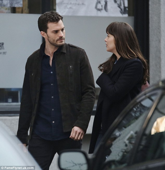 Loved up: Jamie and Dakota were later spotted filming a scene togther
