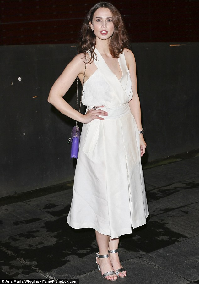 Glamorous and chic: Showcasing her very modern and sartorially striking fashion sense, the actress, 27, donned a white jumpsuit which showed plenty of skin whilst allowing her to retain a glamorous and chic edge