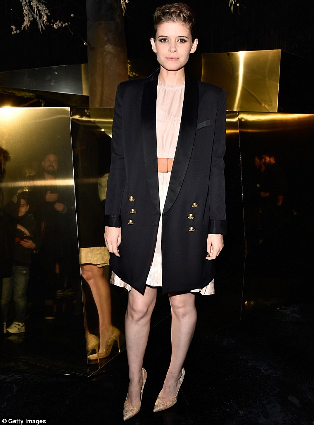 A well-heeled display: The petite star added some height to her frame, while also accentuating her lithe and slender pins. with a pair of champagne stiletto heels