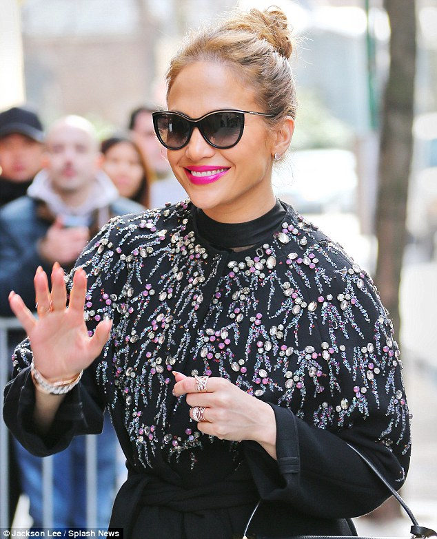 So glam: The 46-year-old star looked gorgeous in a rhinestone-encrusted black coat and chic cat-eye sunglasses