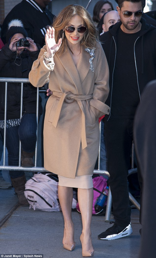 Winter chic: The singer looked chilly as she kept one hand tucked in her pocket