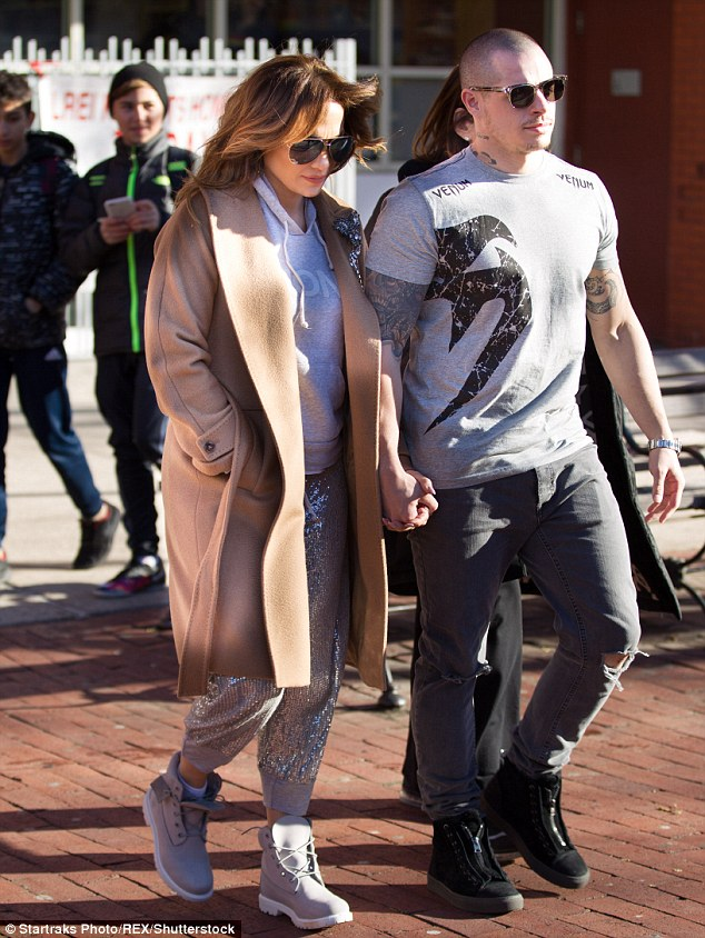 Time to relax: The star changed into sweats (albeit sparkly ones) as she joined beau Casper Smart, 28