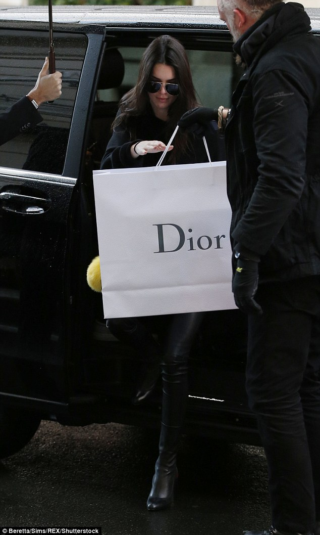 Shop til you drop: Kendall Jenner was splashing the cash at a Dior boutique in Paris, France on Wednesday in between fashion shows