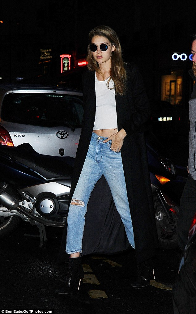 Celeb staple: Despite the darkening skies, Gigi maintained her superstar edge with a pair of quirky circular shades, beneath which the natural beauty looked to be completely make-up free
