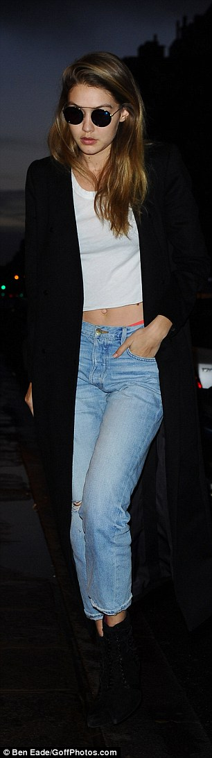 Whoops! Fashioning the laid-back look like a pro, Gigi teamed the garment with ripped boyfriend jeans, with the low-slung denims offering a peep of her coral coloured undergarments