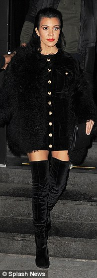Thigh's the limit: Kourtney Kardashian, 36, was styled by Monica in a monochrome look with matching thigh high boots