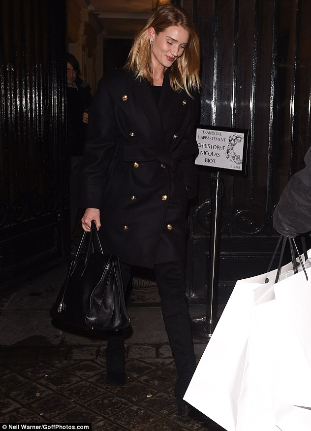 Getting runway ready? Rosie Huntington-Whiteley was spotted leaving Balmain's headquarters, following a fitting, on Wednesday night - just hours after arriving in Paris for Fashion Week