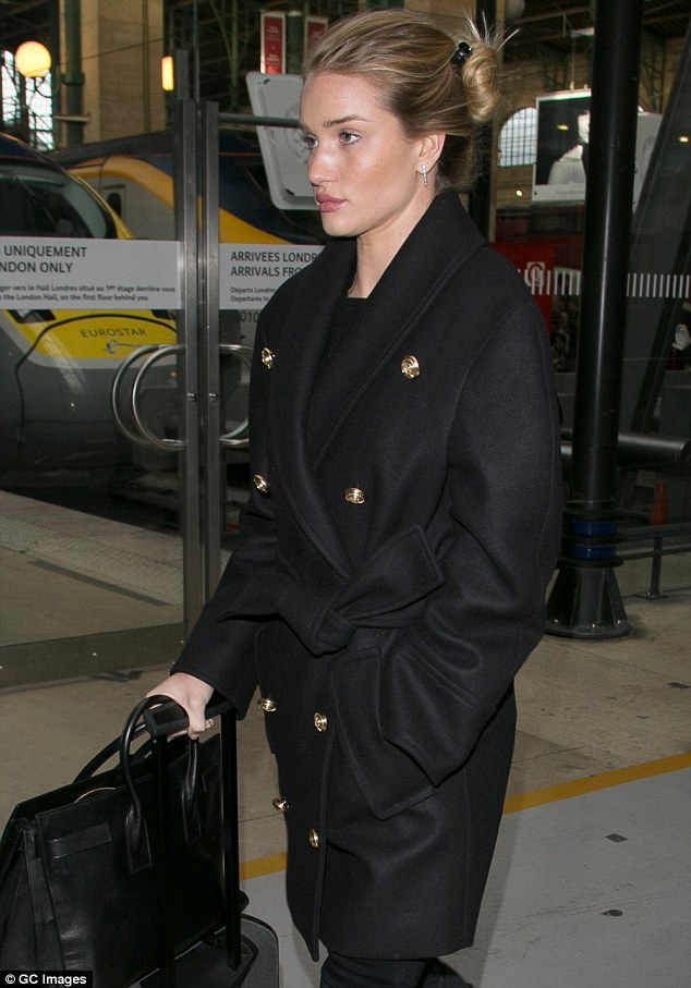 Travelling in style: The 28-year-old British born beauty arrived earlier in the day with her best foot firmly placed forward, as she arrived at the French capital's famous Gare du Nord station in a travel chic, all-black ensemble