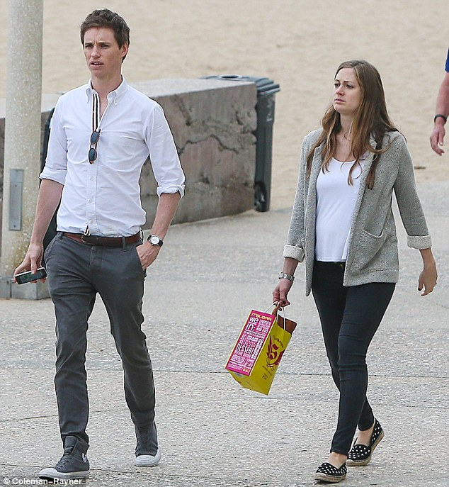 Glowing: The publicist was positively glowing, and appeared to be enjoying her break from London - where the couple live -subtly showed off her blossoming baby bump in a floaty white tank top and stylish grey blazer