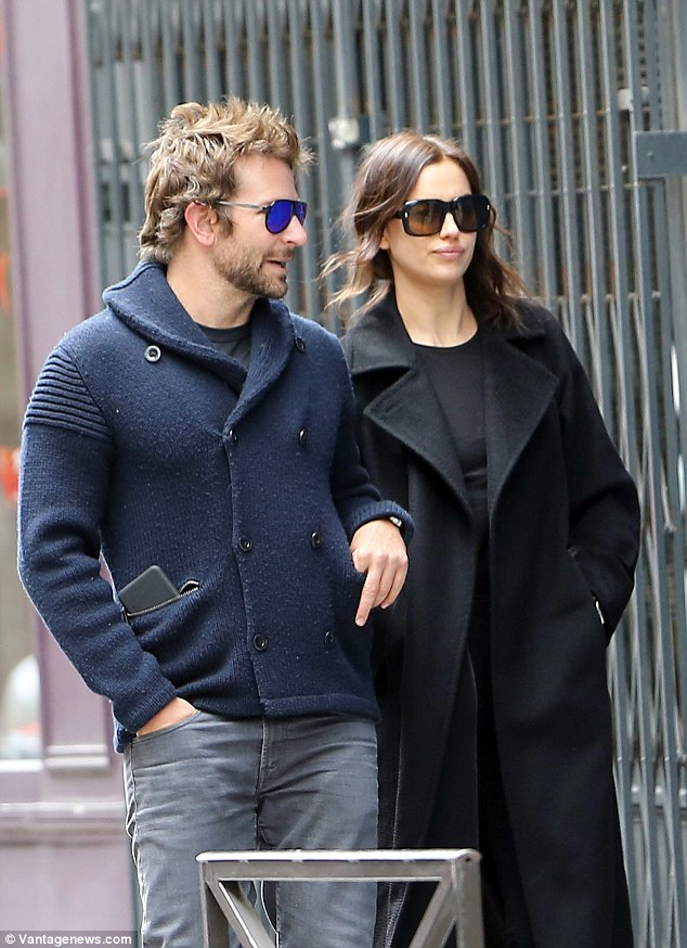 Pared-back: Irina's monochromatic style consisted of a black sweater and skinny jeans, layered beneath a trench coat which looked to provide a welcome source of warmth as she slipped her hands into her pockets