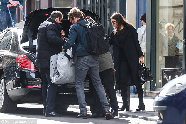 Suited and booted! The couple weren't travelling light as they hauled their luggage into the boot of their vehicle, including what appeared to be a suit by famed designer Tom Ford