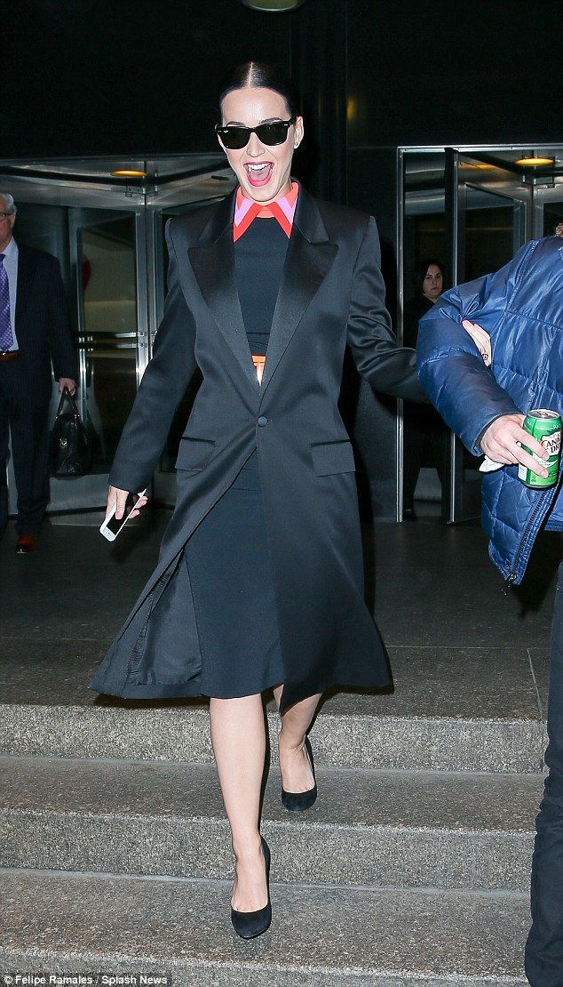 All smiles! Katy Perry was the picture of happiness as she left the Empire State Building in New York City on Tuesday, fresh from her Hawaiian holiday with boyfriend Orlando Bloom