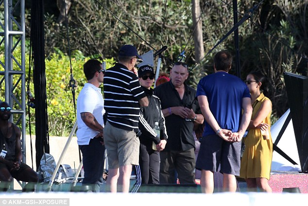 Work mode: Katy had a talk with her team ahead of the concert at the luxury resort